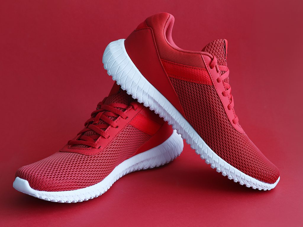 red sneakers on red background