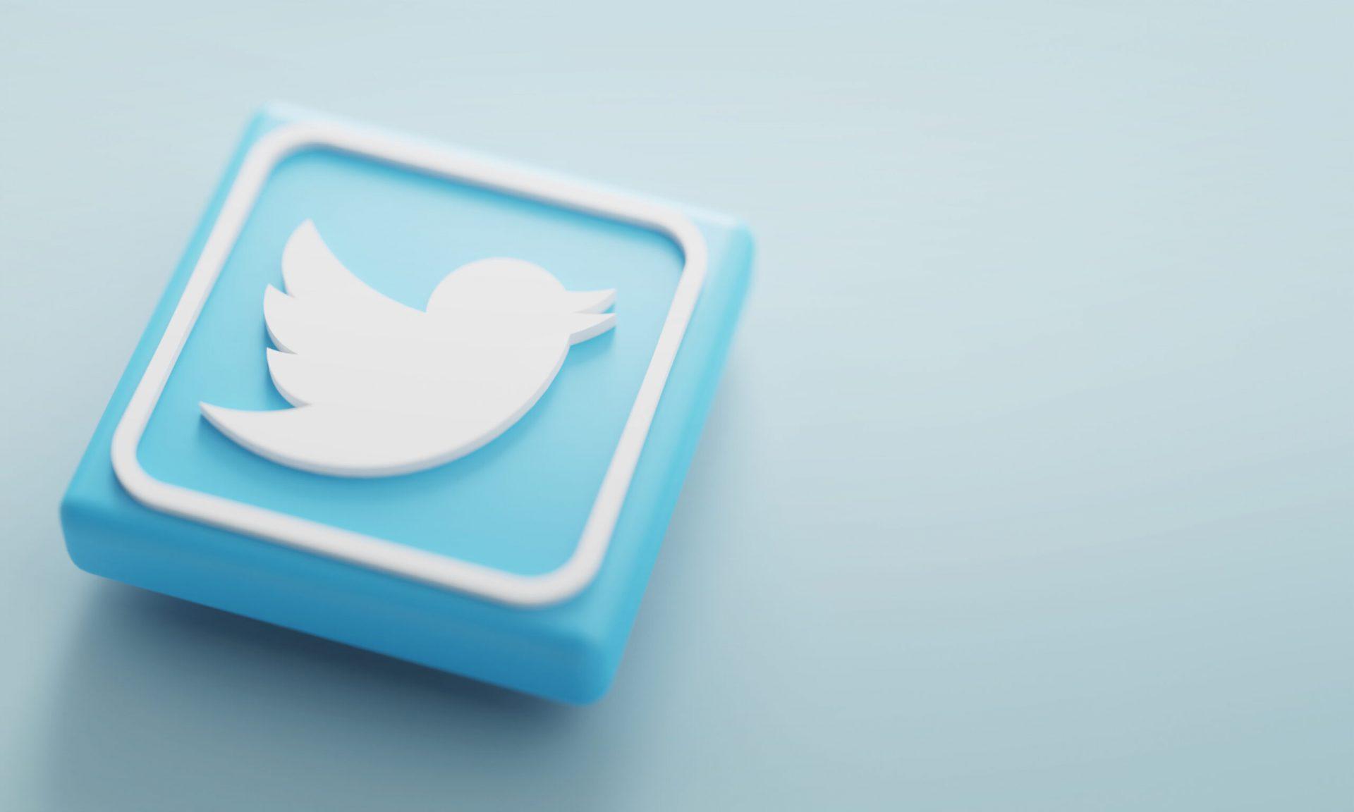 twitter logo on a blue tile