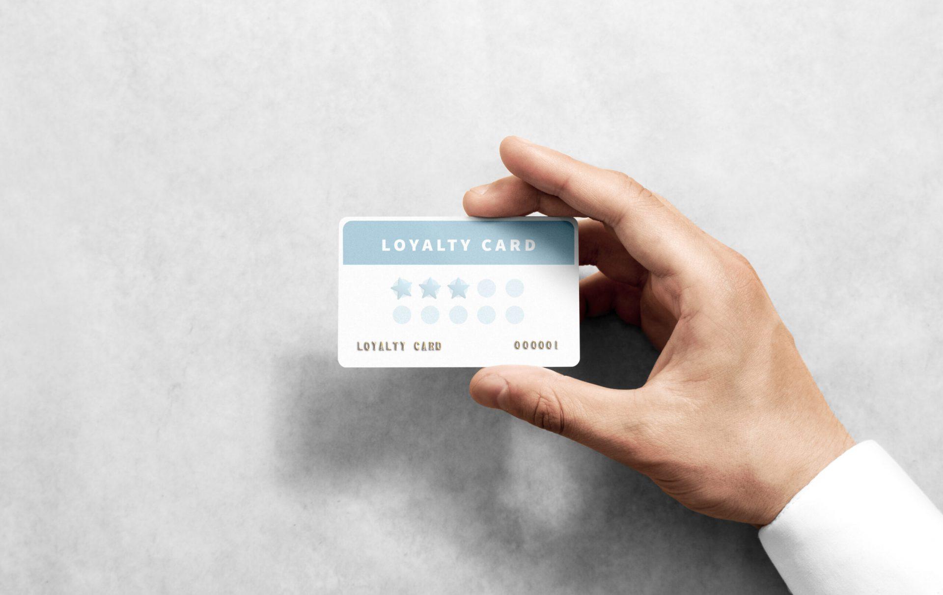 hand holding restaurant customer loyalty program card