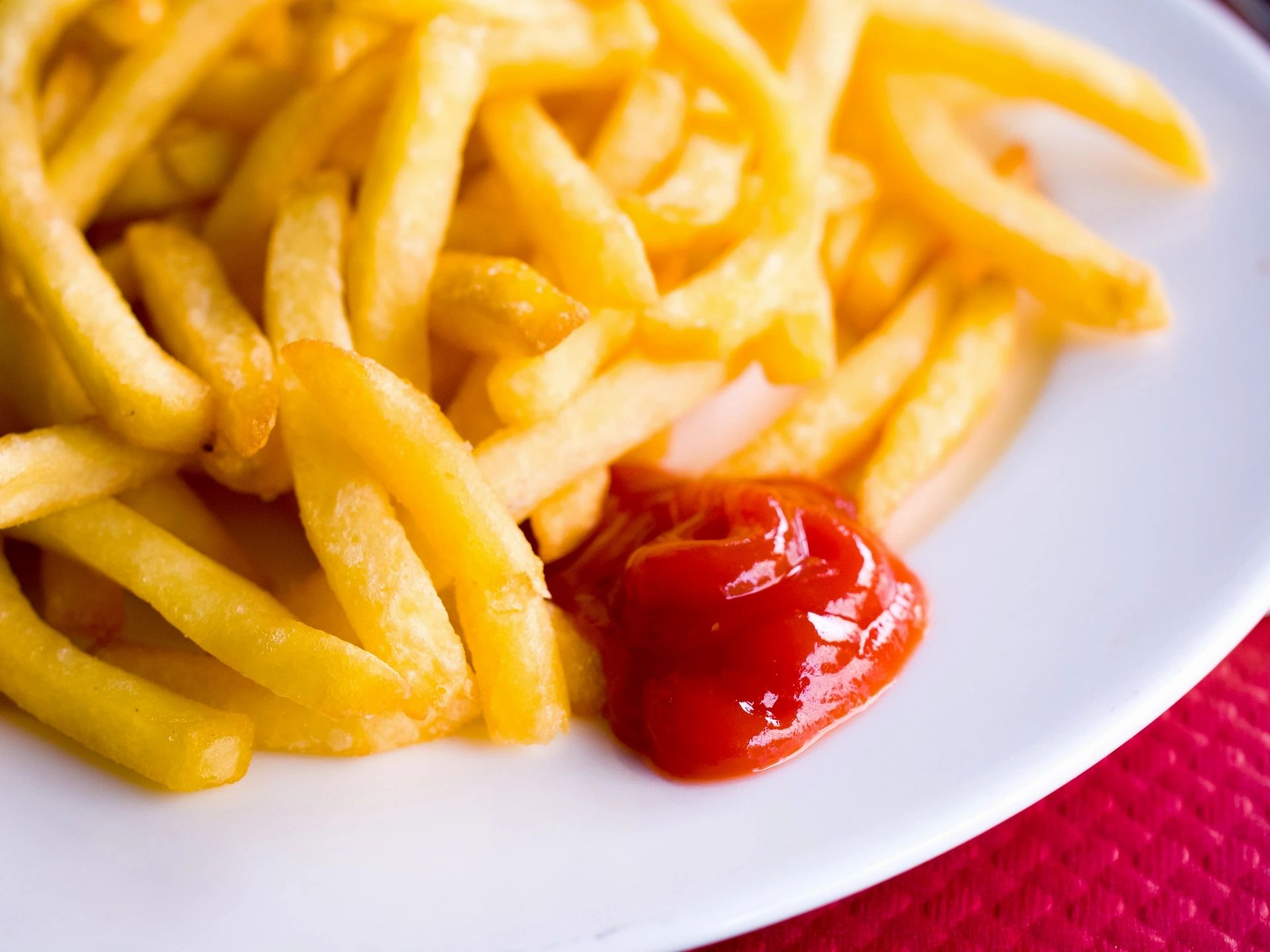 French fries on a plate with ketchup